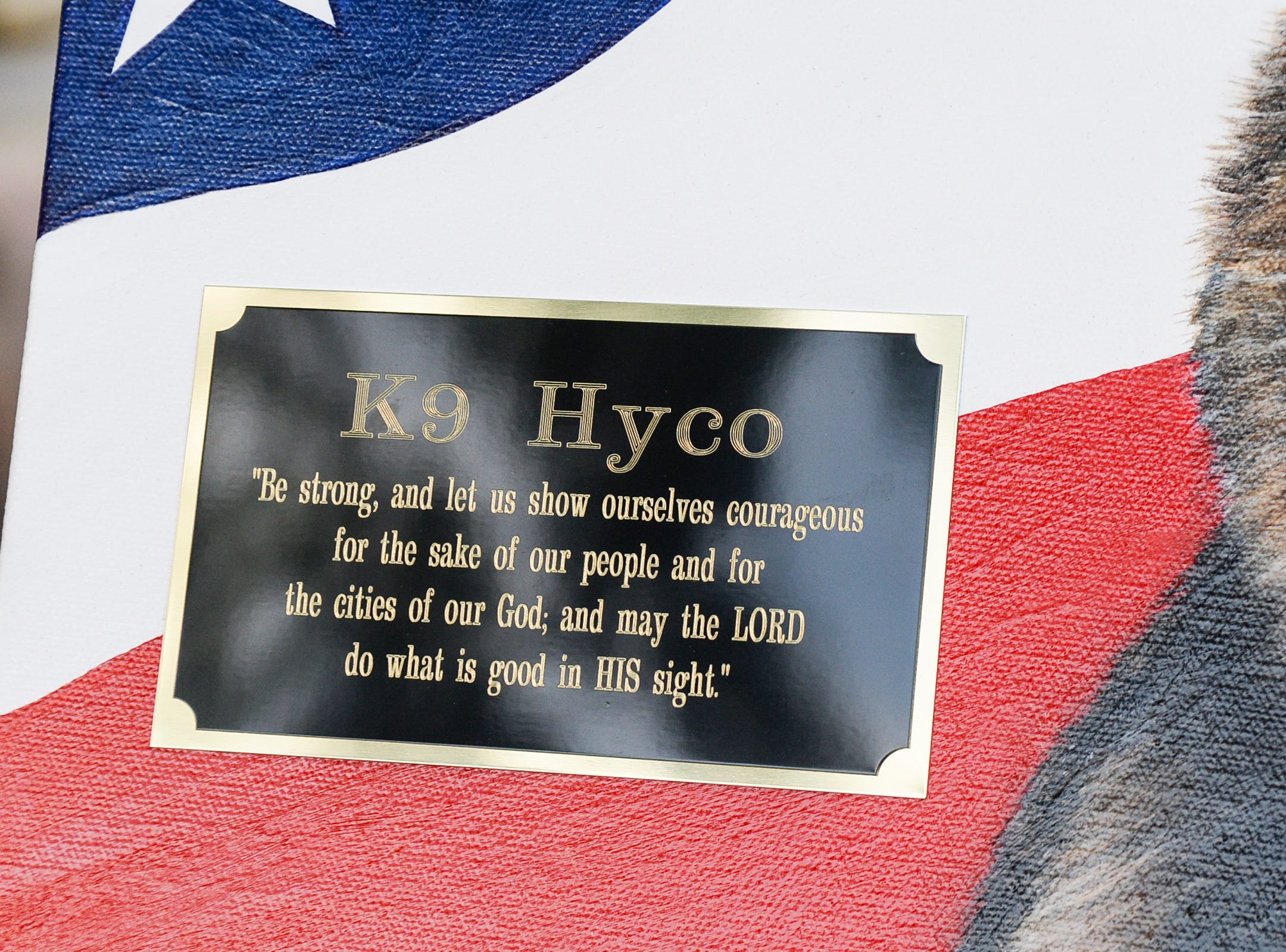 Artist Loreena Pantaleone, of Pennsylvania, presented Brandon Surratt a painting of Hyco, during the 2019 Peace Officer Memorial Service Wednesday May 15, 2019, in front of the Anderson County courthouse. People attended to help honor the lives of officers lost in the line of duty. Surratt, a former Anderson County Sheriff Deputy who lost his K-9 Hyco in the line of duty in 2015, spoke about serving as an officer.
