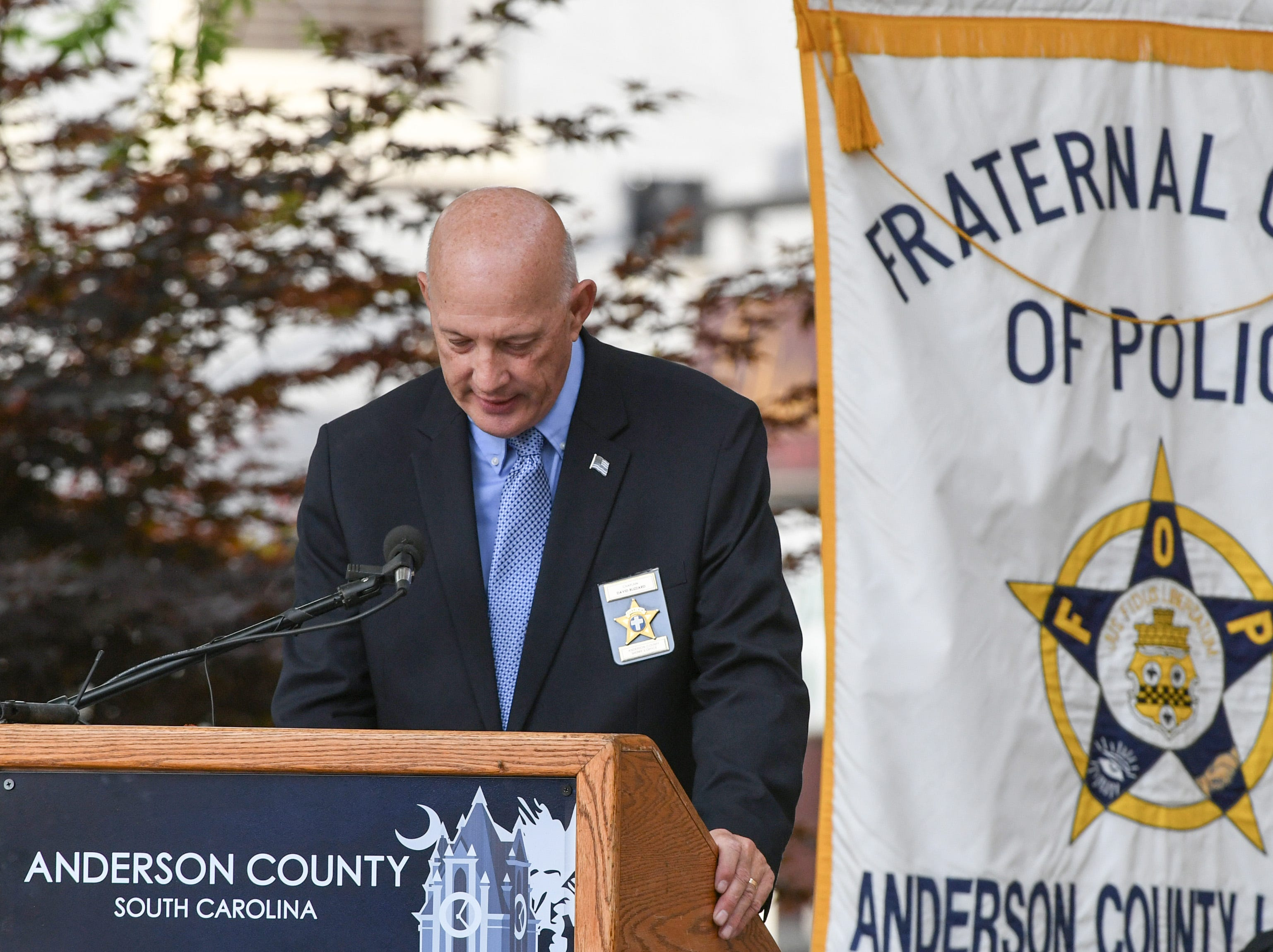 Rev. David Blizzard offers invocation during the 2019 Peace Officer Memorial Service Wednesday May 15, 2019, in front of the Anderson County courthouse. People attended to help honor the lives of officers lost in the line of duty.