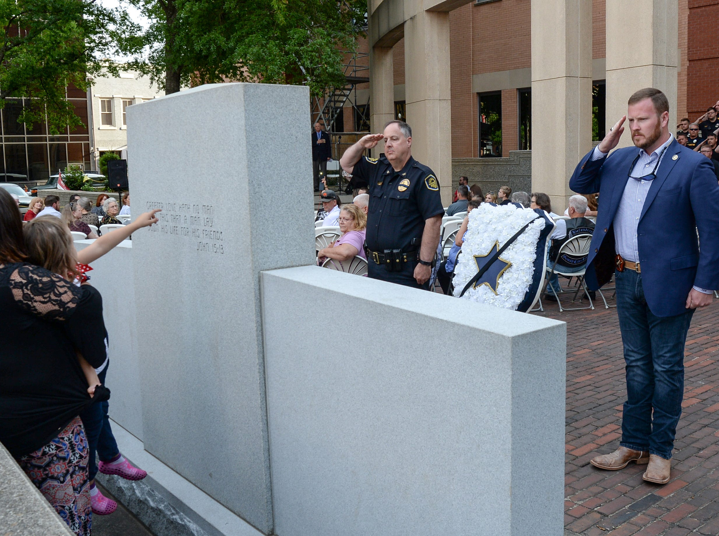 Anderson Chief Jim Stewart, left, and Sheriff Chad McBride salute at the courthouse memorial after carrying the wreath during the 2019 Peace Officer Memorial Service Wednesday May 15, 2019. People attended to help honor the lives of officers lost in the line of duty.