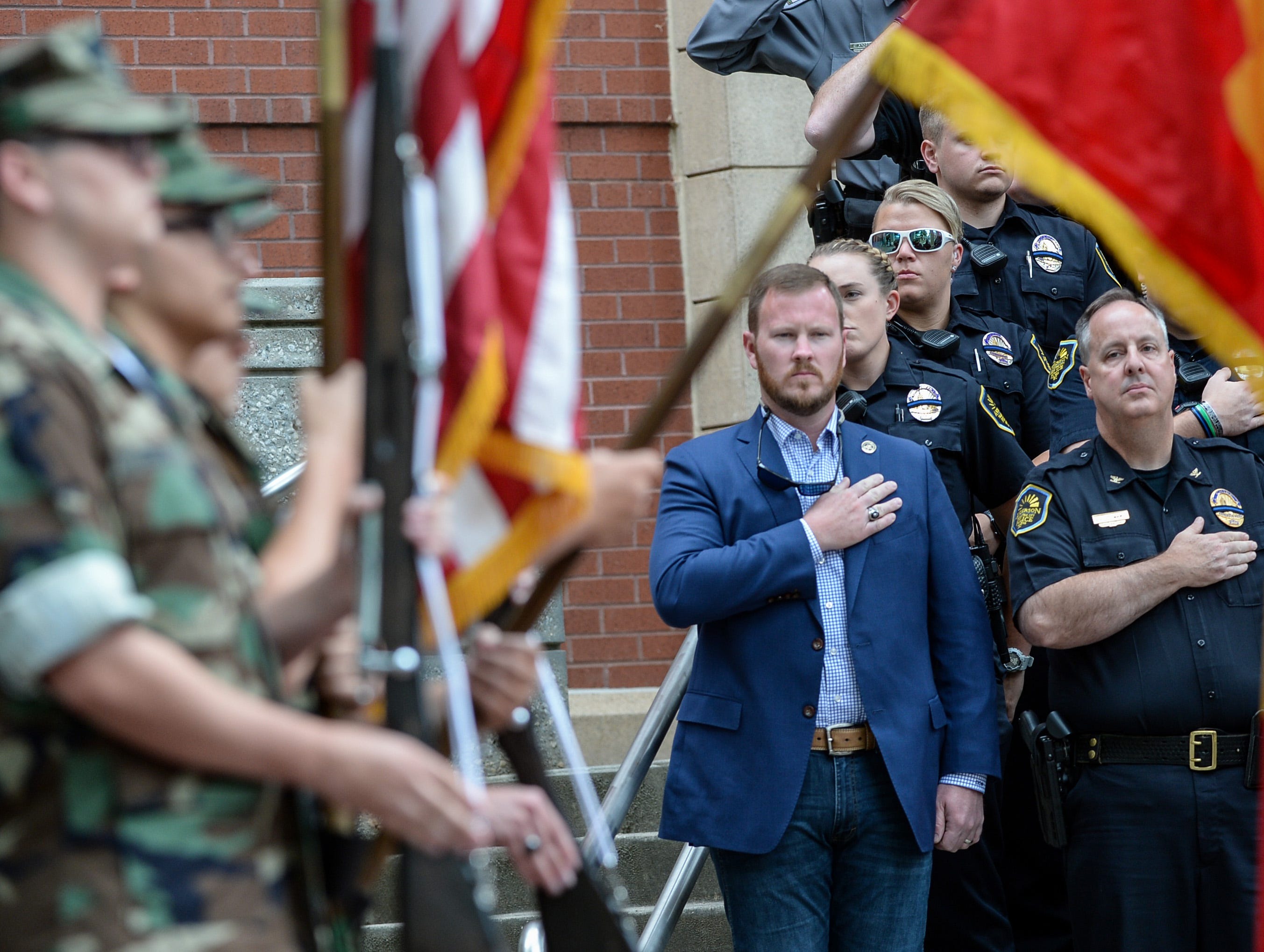 Sheriff Chad McBride, left, and Anderson Chief Jim Stewart salute as the Electric City Young Marines present colors for the 2019 Peace Officer Memorial Service Wednesday May 15, 2019. People attended to help honor the lives of officers lost in the line of duty.