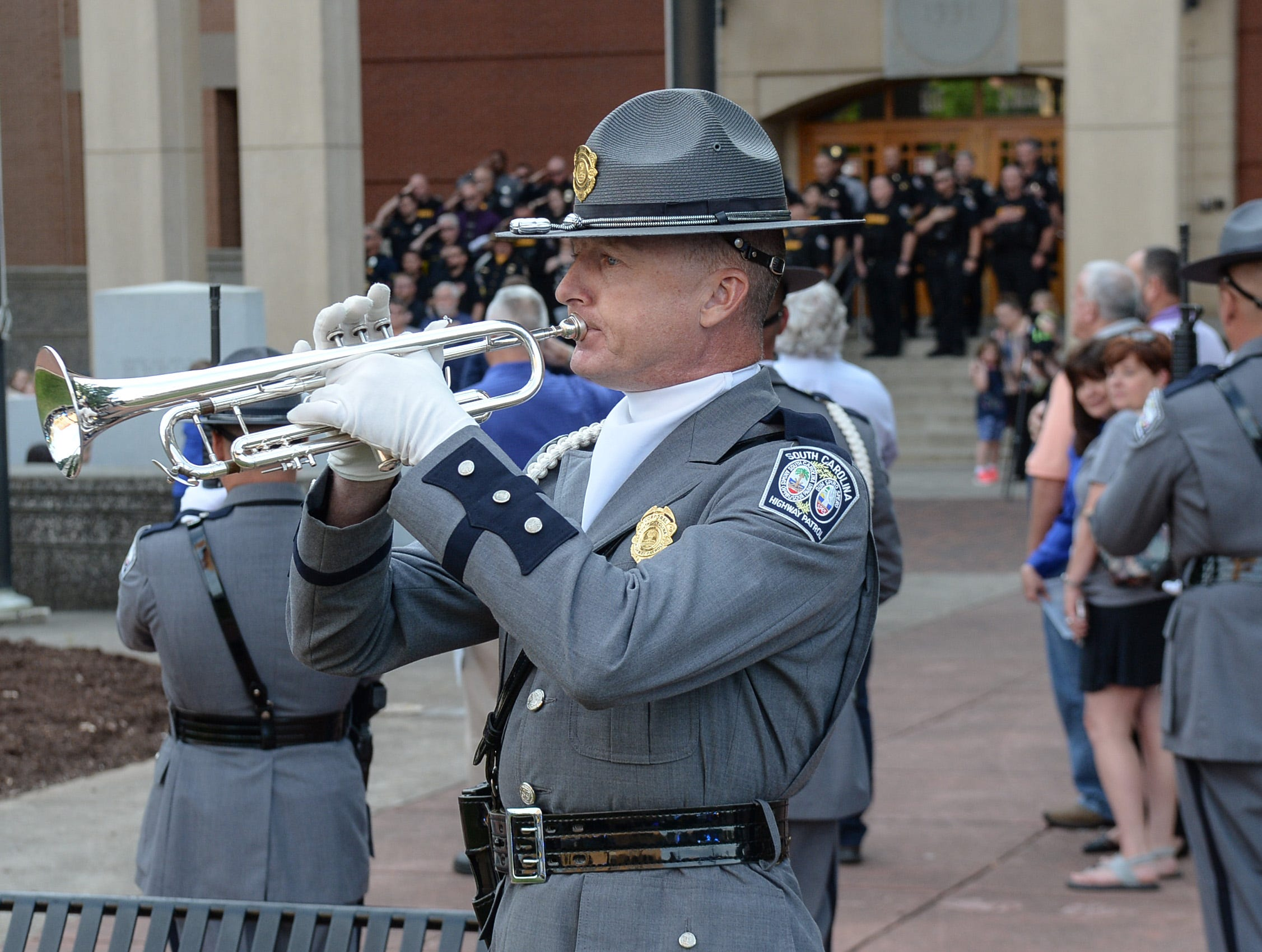 South Carolina Highway Patrol Honor Guard Jeff Baker of Columbia plays 'Taps' during the 2019 Peace Officer Memorial Service Wednesday May 15, 2019, in front of the Anderson County courthouse. People attended to help honor the lives of officers lost in the line of duty.