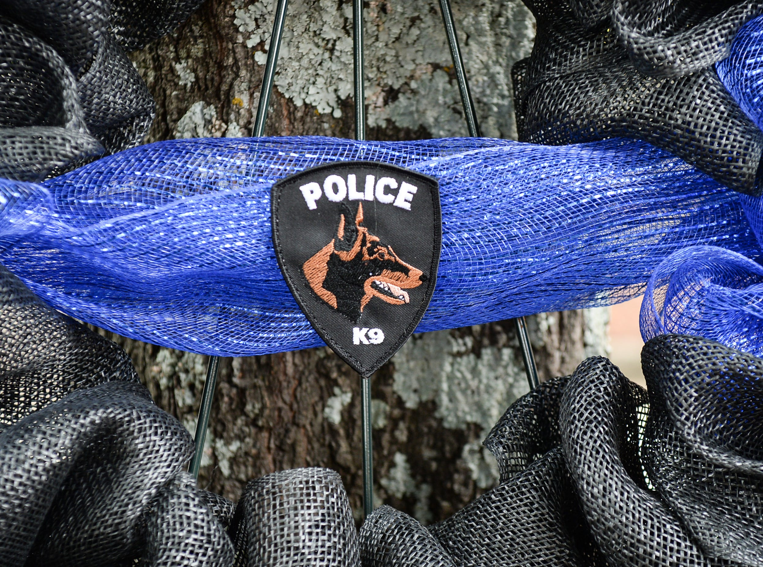 The K-9 Memorial wreath during the 2019 Peace Officer Memorial Service Wednesday May 15, 2019. People attended to help honor the lives of officers lost in the line of duty.