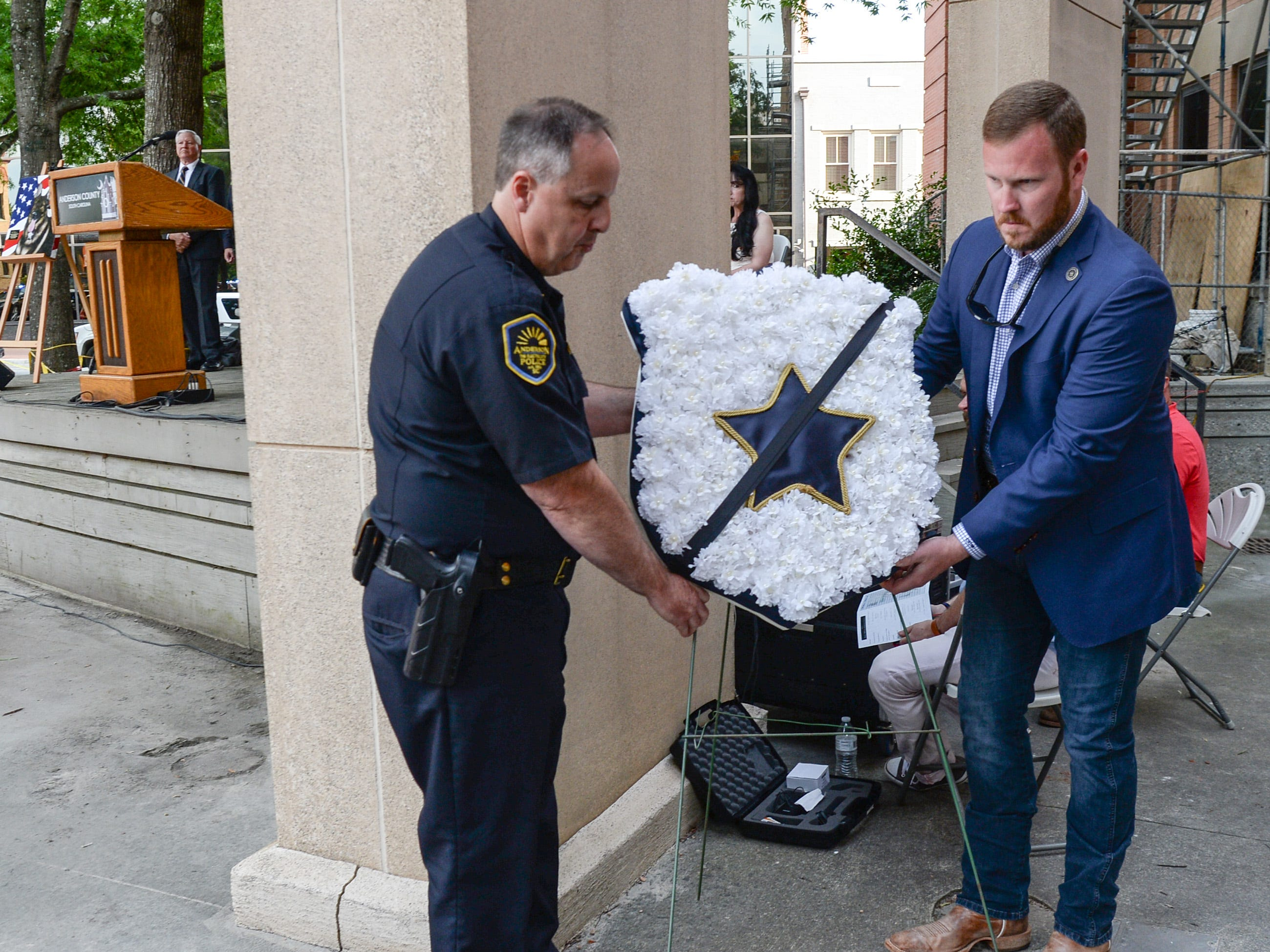 Chief Jim Stewart of the Anderson police department and Sheriff Chad McBride carry a wreath to the courthouse memorial during the 2019 Peace Officer Memorial Service Wednesday May 15, 2019. People attended to help honor the lives of officers lost in the line of duty.