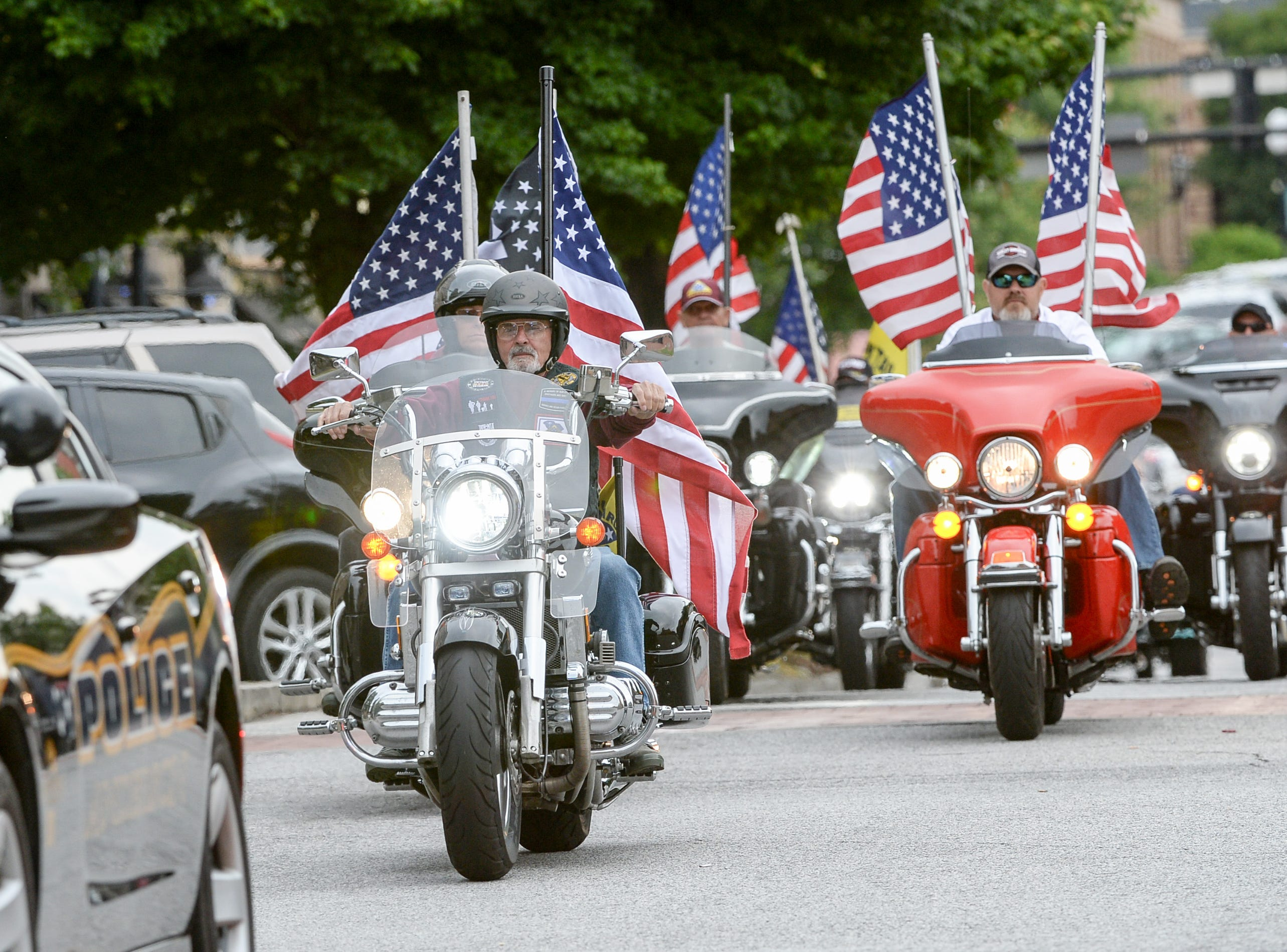 A procession of law enforcement ride with the Patriot Guard and others on motorcycles ride the 2019 Peace Officer Memorial Service Wednesday May 15, 2019. People attended to help honor the lives of officers lost in the line of duty.