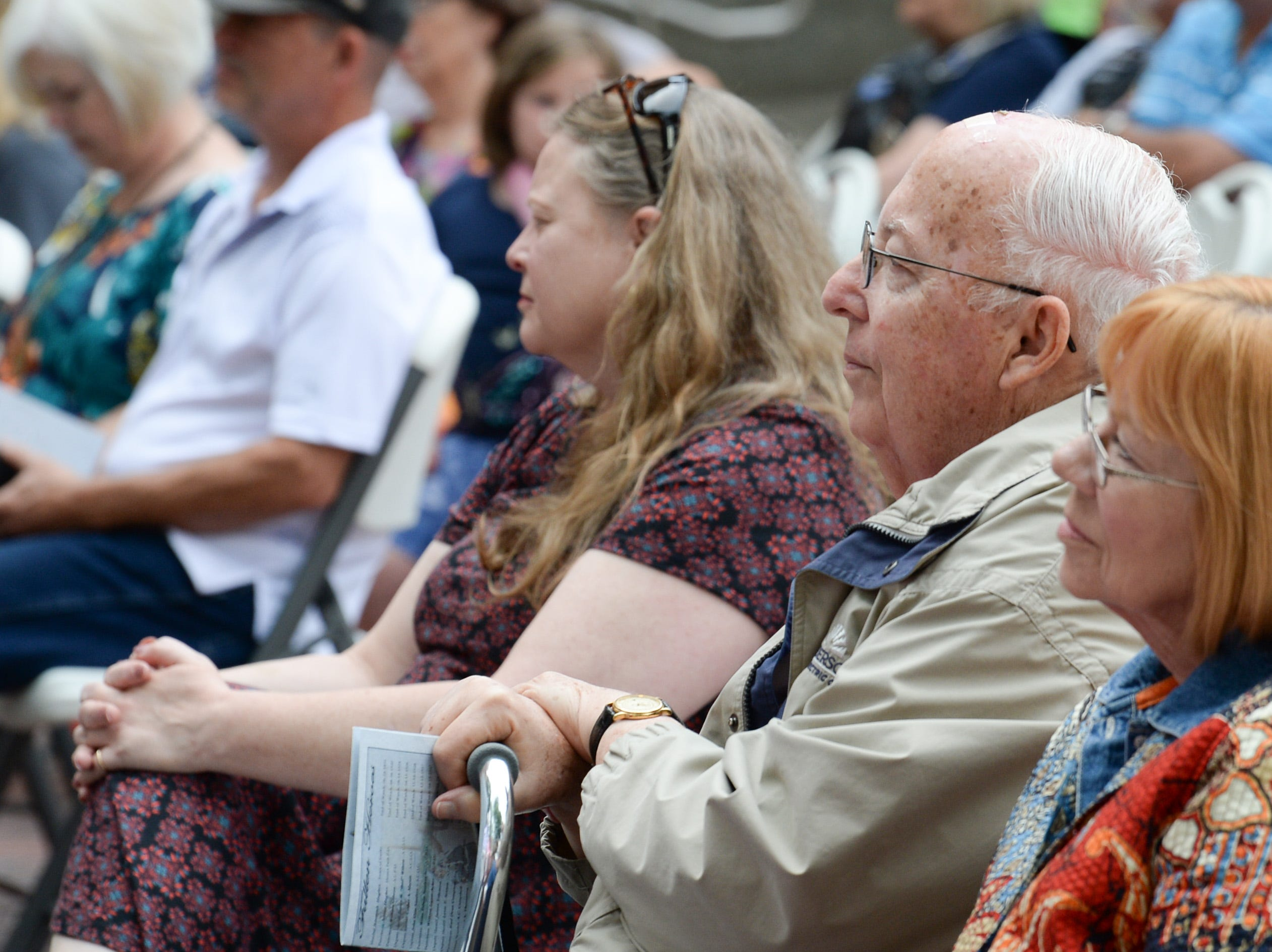 Retired city Judge Ken Mattison listens to keynote speaker Jackie Swindler, Director of the State Criminal Justice Academy, speaking during the 2019 Peace Officer Memorial Service Wednesday May 15, 2019. People attended to help honor the lives of officers lost in the line of duty.