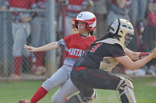 Palmetto's Kathryn Drake slides into home to score. Palmetto High hosted Hartsville in Game 2 of the Class AAAA softball tournament Wednesday, May 15, 2019.