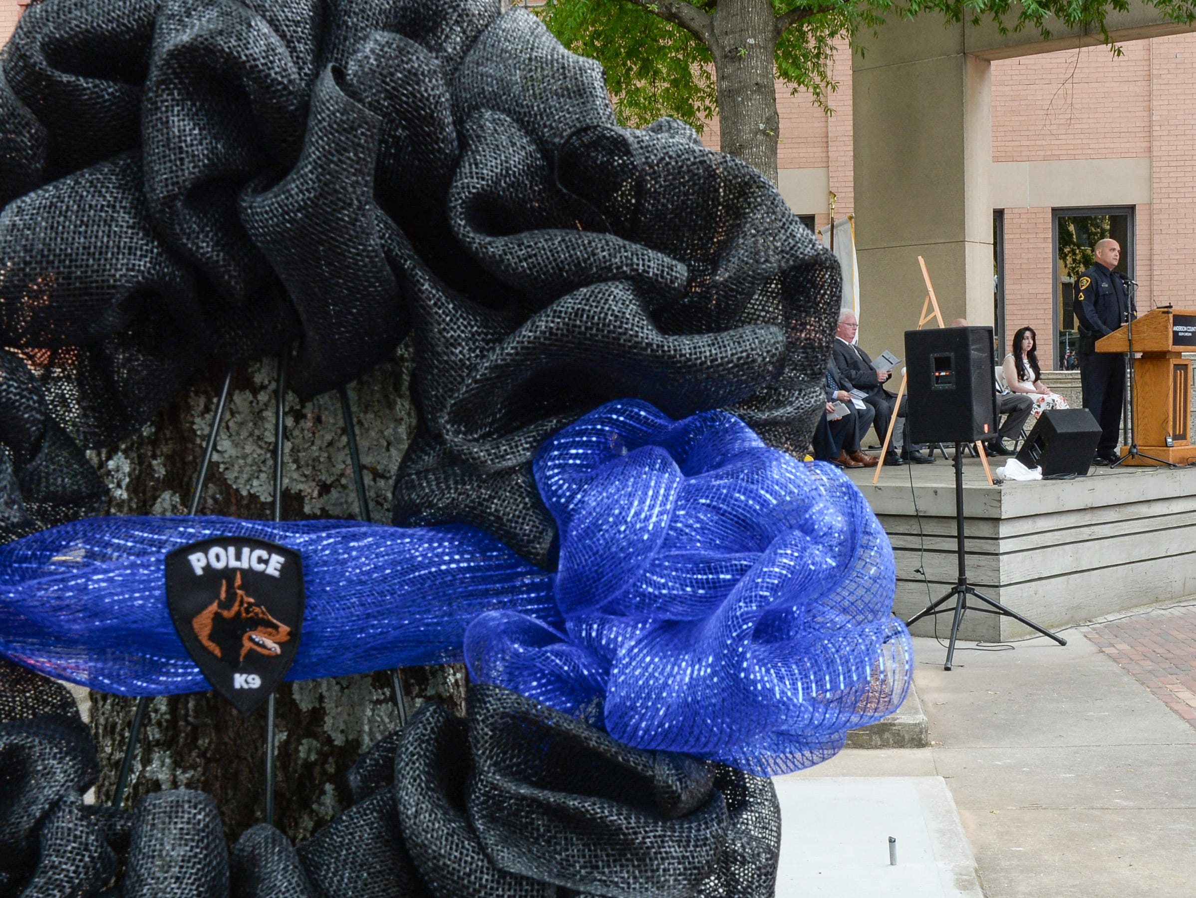 Brandon Surratt of Greenville County Sheriff's Office talks about serving and thanks those for creating the new Fraternal Order of Police monument for fallen K-9 Duchess and Hyco, during the 2019 Peace Officer Memorial Service Wednesday May 15, 2019. People attended to help honor the lives of officers lost in the line of duty.