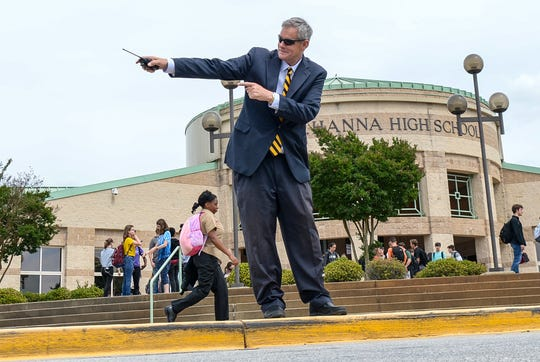 Shawn Tobin, T.L. Hanna High School principal, directs traffic after school Wednesday. Tobin, who went from assistant principal at Westside in the spring of 2015 to Hanna principal the next fall, leaves the school after the spring of 2019, undecided about what his next adventure and challenge in life will be.