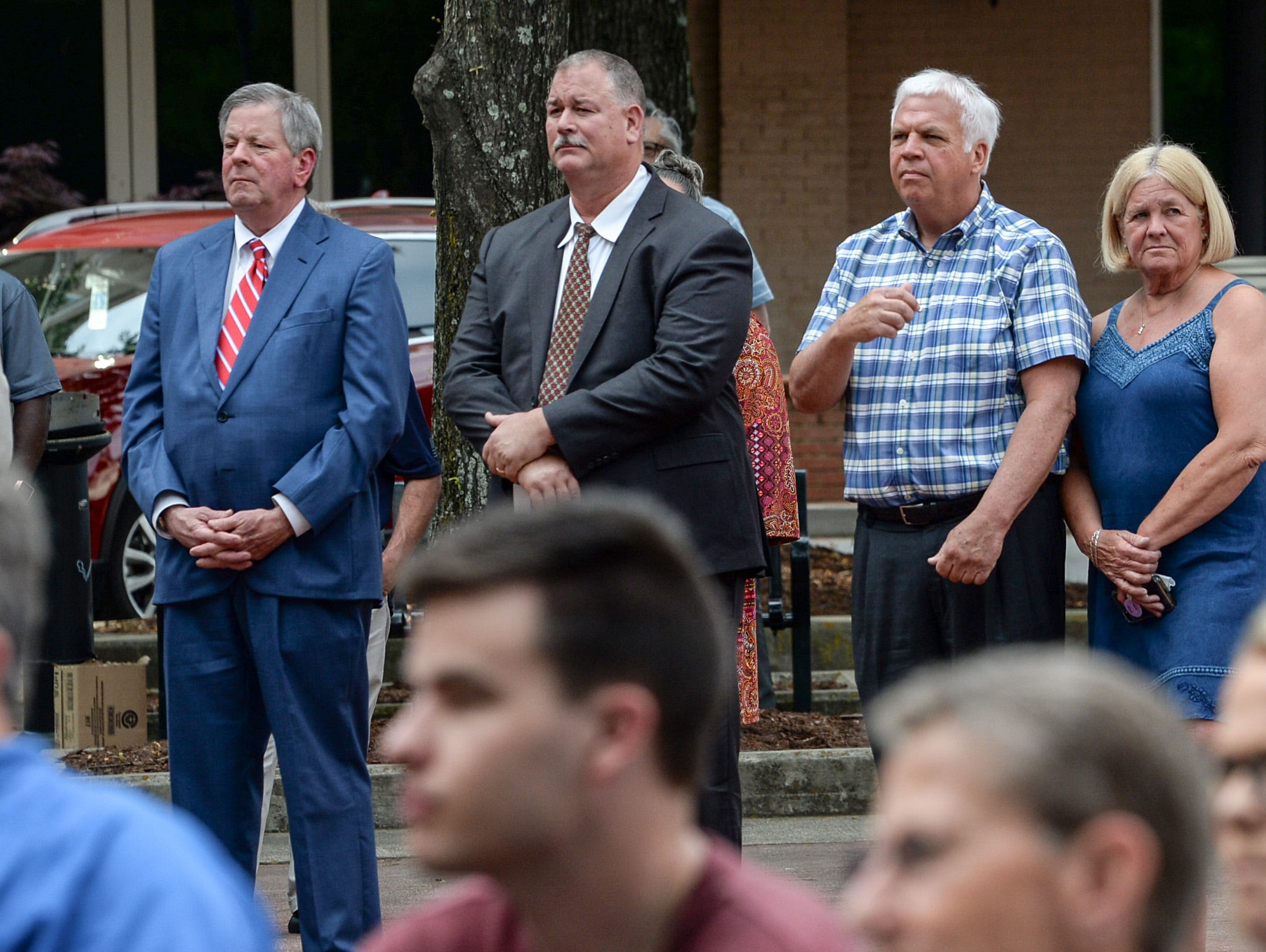 Richard Shirley, left, Anderson County Clerk of Courts, David Wagner, 10th Circuit Solicitor, and Greg Shore, Anderson County Cornoner, listen to keynote speaker Jackie Swindler, Director of the State Criminal Justice Academy, speaking during the 2019 Peace Officer Memorial Service Wednesday May 15, 2019. People attended to help honor the lives of officers lost in the line of duty.