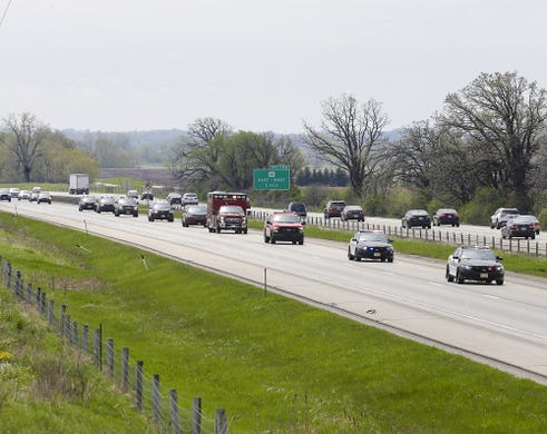 A procession for a fallen Appleton firefighter passes through Fond du Lac County Thursday, May 16, 2019 on Interstate 41 near the Lincoln Road overpass on his way from the Milwaukee Medical Examiner's office to Brettschneider-Trettin-Nickel Funeral Chapel in Appleton. The firefighter was killed when he was shot, along with three other people at a medical emergency call at the Valley Transit Center in downtown Appleton. Doug Raflik/USA TODAY NETWORK-Wisconsin