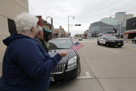 Citizens show their support during a procession for a firefighter shot and killed while responding to a medical call at the Valley Transit Center moves along College Avenue Thursday, May 16, 2019, in downtown Appleton, Wis.  Dan Powers/USA TODAY NETWORK-Wisconsin