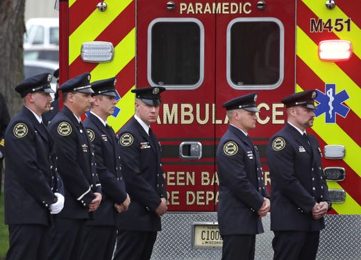 Members of the Appleton Fire Department stand next to an ambulance at the Brettschneider-Trettin-Nickel Funeral Chapel carrying an Appleton firefighter who was shot and killed while responding to a medical call at the Valley Transit Center at the end of a procession that traveled from Milwaukee to Appleton Wednesday, May 16, 2019, in Appleton, Wis.  Danny Damiani/USA TODAY NETWORK-Wisconsin