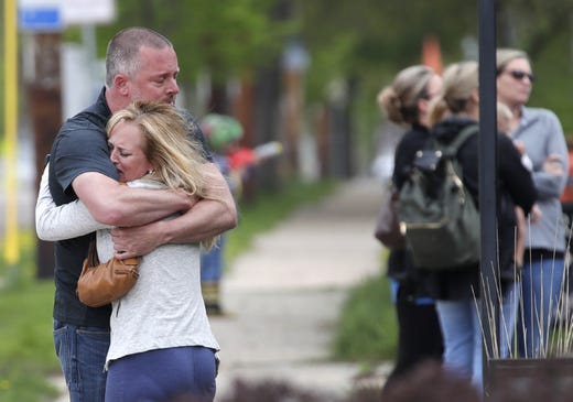 Those gathered at Brettschneider-Trettin-Nickel Funeral Chapel hug before the procession for a firefighter who was shot and killed while responding to a medical call at the Valley Transit Center Wednesday, May 16, 2019, in Appleton, Wis.  Danny Damiani/USA TODAY NETWORK-Wisconsin
