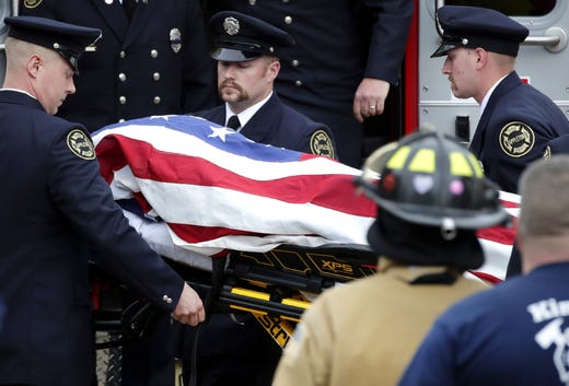 A firefighter who was shot and killed while responding to a medical call at the Valley Transit Center is draped in an American Flag and taken out of an ambulance at Brettschneider-Trettin-Nickel Funeral Chapel which ended a procession that went from Milwaukee to Appleton at Wednesday, May 16, 2019, in Appleton, Wis.  Danny Damiani/USA TODAY NETWORK-Wisconsin