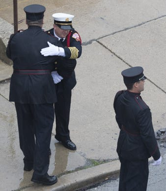 A St. Francis firefighter embraces a colleague after being part of an honor guard for an Appleton firefighter Thursday, May 16, 2019 outside the Milwaukee County Medical Examiner's Office, 933 W. Highland Ave. in Milwaukee, Wis. The firefighter was shot, along with three other people, while at the scene of a medical emergency, according to an Appleton Fire Department news release early Thursday morning. The firefighter, a 14-year veteran whose name was not released, died at an Appletom area hospital.   MARK HOFFMAN/MILWAUKEE JOURNAL SENTINEL