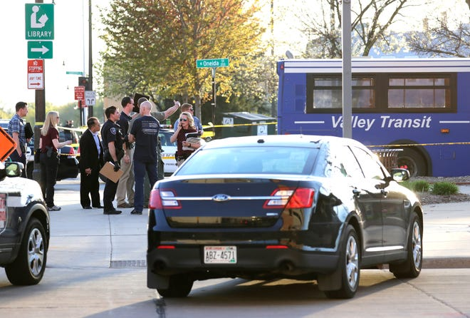 Authorities investigate a deadly shooting at the Valley Transit Center in downtown Appleton.
