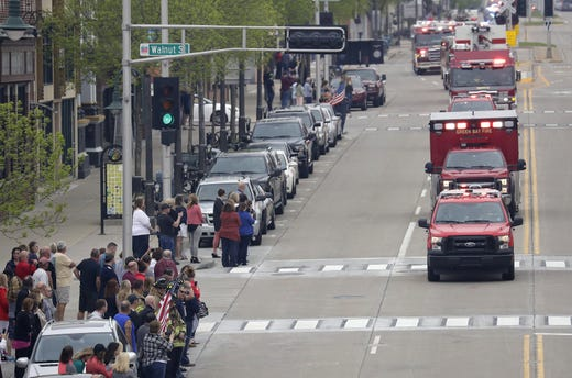 A procession for a firefighter shot and killed while responding to a medical call at the Valley Transit Center moves along College Avenue Thursday, May 16, 2019, in downtown Appleton, Wis.  Dan Powers/USA TODAY NETWORK-Wisconsin