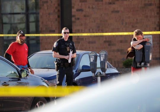 Authorities investigate a shooting at the Valley Transit Center Wednesday, May 15, 2019, in Appleton, Wis.
