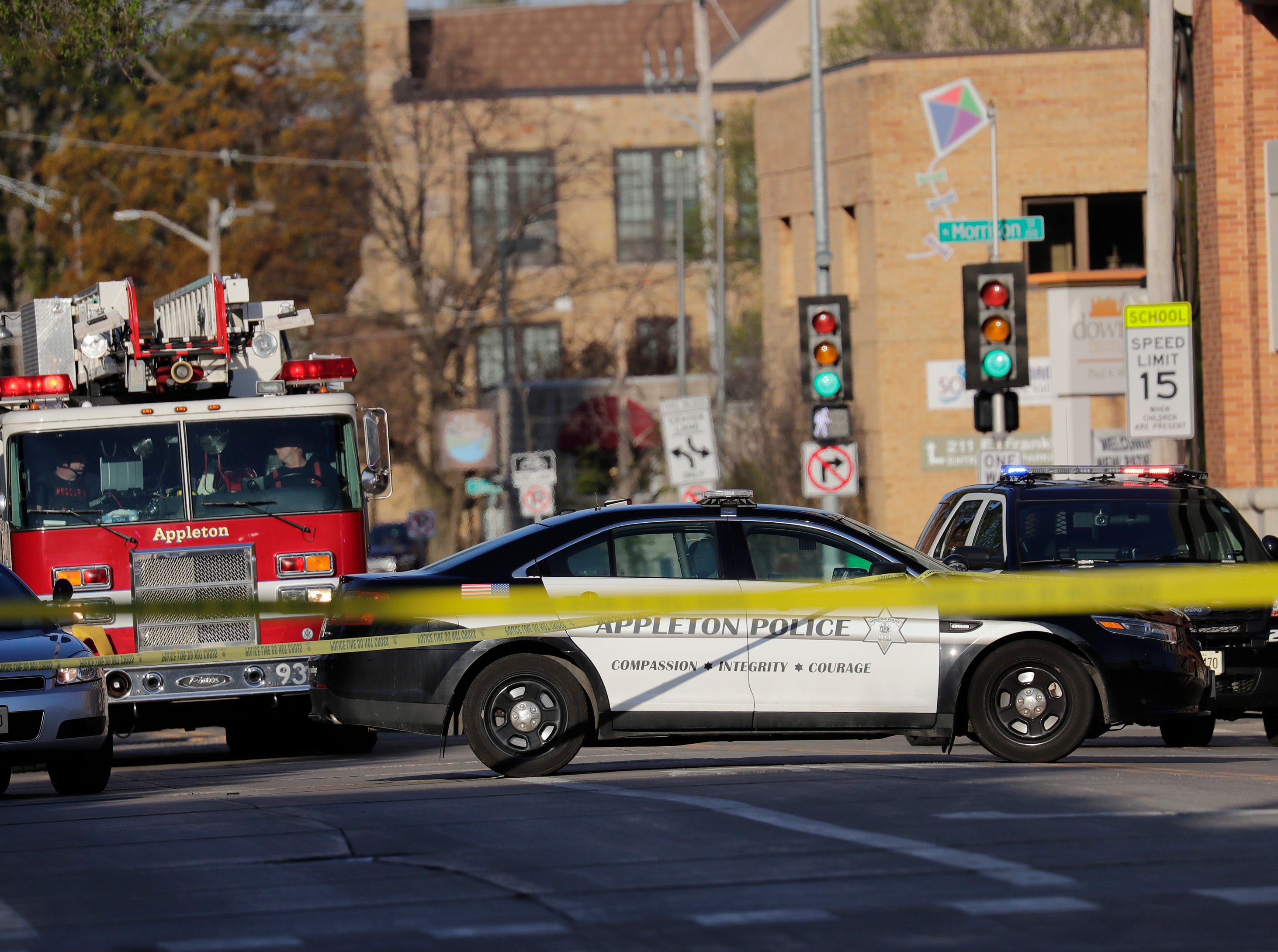 """Authorities investigate a shooting at the Valley Transit Center Wednesday, May 15, 2019, in Appleton, Wis. Paramedics took """"several"""" people to the hospital after a shooting, authorities said. Among the people injured is a police officer and a firefighter, Appleton Police spokeswoman Meghan Cash said."""