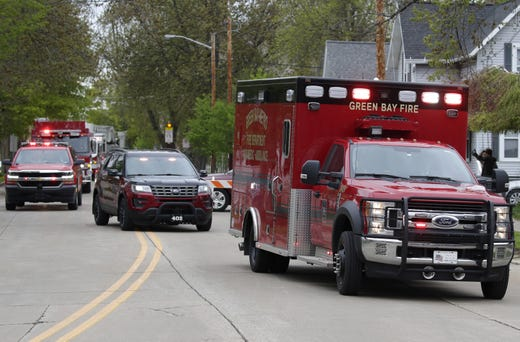The proccession for Appleton firefighter Mitchell F. Lundgaard, who was shot and killed while responding to a medical call at the Valley Transit Center, ends at Brettschneider-Trettin-Nickel Funeral Chapel Wednesday, May 16, 2019, in Appleton, Wis.  Danny Damiani/USA TODAY NETWORK-Wisconsin