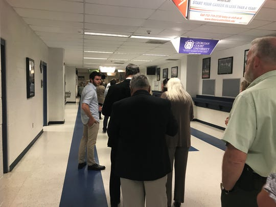 Ocean County Republican Committee members wait in line at the RWJBarnabas Health Arena for up to 20 minutes on Wednesday night in order to register their attendance to vote.