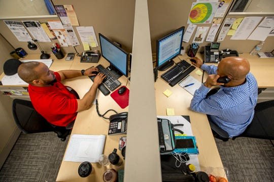 Volunteers work at NJ Connect for Recovery's call center