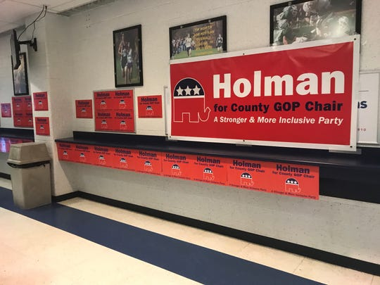Banners and signs for Frank B. Holman III line the other side of the corridor at the RWJBarnabas Health Arena on the campus of Toms River High School North.