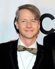 In this June 8, 2014 file photo, John Cameron Mitchell arrives at the 68th annual Tony Awards in New York.