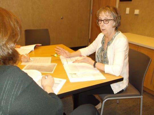 Lynda McDonald (right) leads a Family Education Workshop.