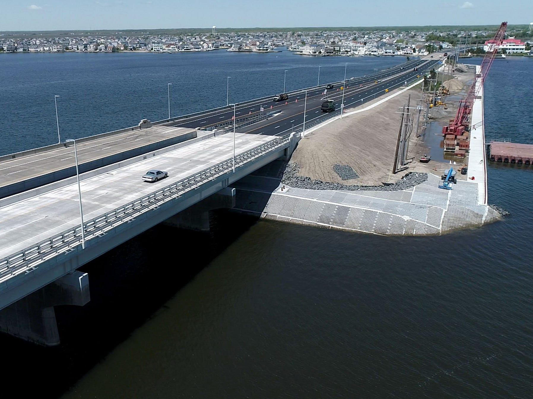 Construction has been completed on both spans of the Route 72 bridge over the Barnegat Bay.  This view on Wednesday, May 15, 2019, looks west towards Stafford Township.
