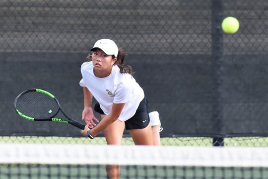 Abilene High's Ruth Hill follows through on a serve during the Class 6A girls singles quarterfinals at the UIL state tournament in College Station on Thursday. Hill won her quarterfinal before falling in the semifinals to earn the bronze medal.