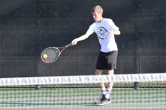 Archer City's Davis Mays hits a shot during the Class 2A boys singles quarterfinal at the state tournament in College Station on Thursday, May 16, 2019. Mays fell 6-1, 6-0.