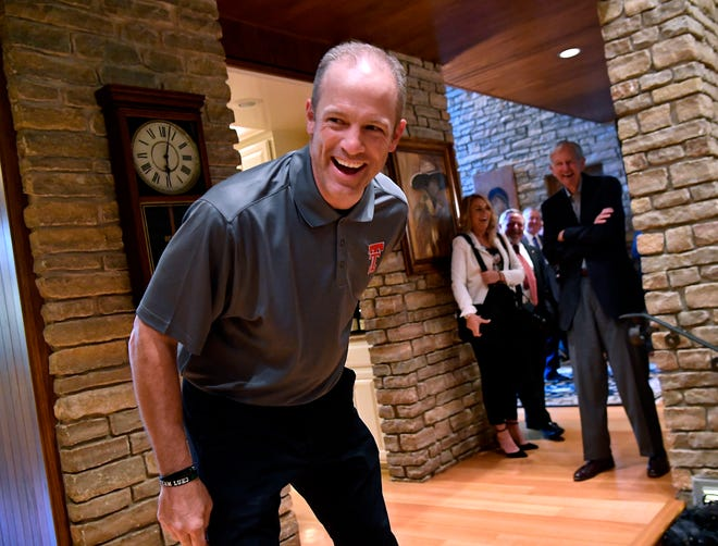 New Texas Tech head football coach Matt Wells laughs during a visit with Tech alums and fans at Scott Dueser's home Tuesday May 14, 2019.