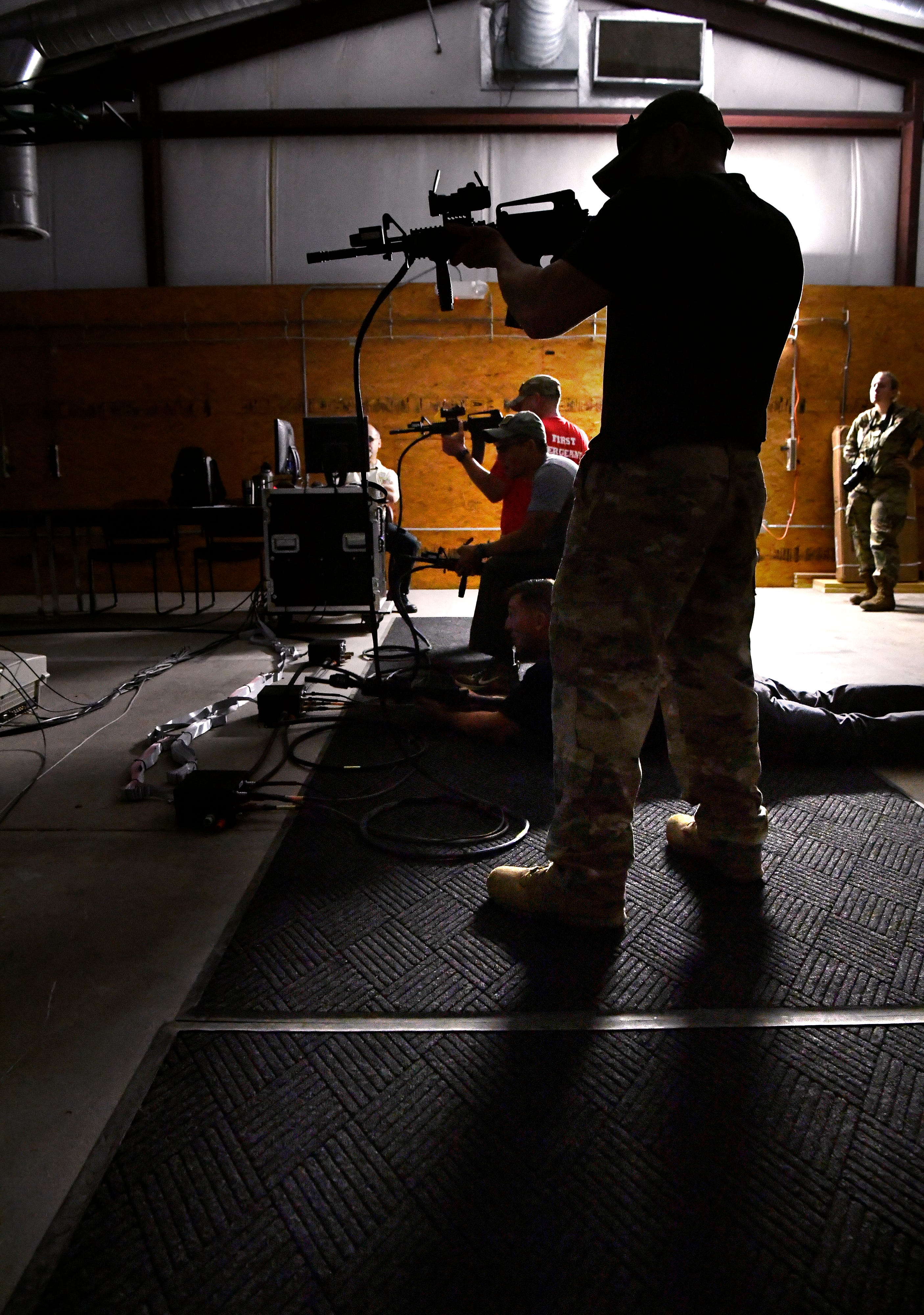 Senior Msgt. Pablo Rodriguez, of the 7th EMS at Dyess Air Force Base, fires an electronic M-16 during an obstacle course on base during a National Police Week event Wednesday. The military police officers were shooting with a computerized simulator.