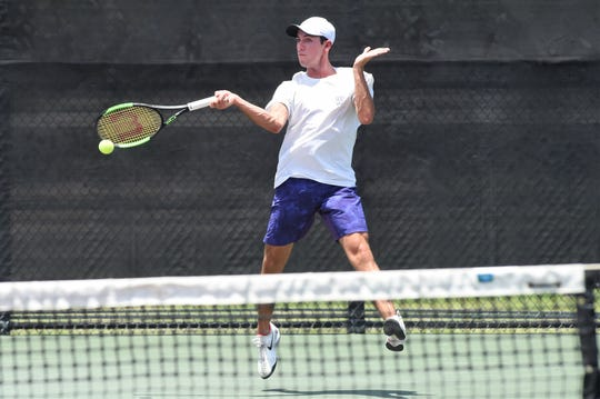 Wylie's Lane Adkins returns a serve during the Class 5A mixed doubles quarterfinal at the state tournament in College Station on Thursday, May 16, 2019. Adkins and Analeah Elias dropped the match 6-4, 7-6(4).