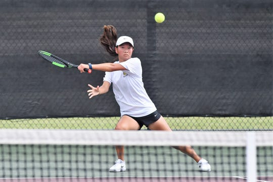 Abilene High's Ruth Hill follows through on a shot during the Class 6A girls singles quarterfinals at the UIL state tournament in College Station on Thursday. Hill won 6-3, 6-4 before dropping a three-set match in the semifinals.