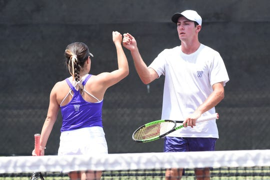 Wylie's Lane Adkins, right, fist bumps Analeah Elias during the Class 5A mixed doubles quarterfinal at the state tournament in College Station on Thursday, May 16, 2019. Adkins and Elias dropped the match 6-4, 7-6(4).
