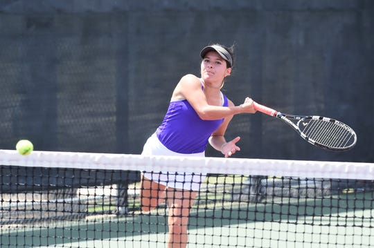 Wylie's Analeah Elias follows through on a shot during the Class 5A mixed doubles quarterfinal at the state tennis tournament in College Station. Lane Adkins and Elias dropped the match 6-4, 7-6(4).