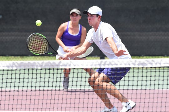 Wylie's Lane Adkins hits a shot at the net in front of partner Analeah Elias during the Class 5A mixed doubles quarterfinal at the state tournament in College Station. Adkins and Elias dropped the match 6-4, 7-6(4).