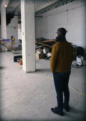 Mike Semenac, co-founder of Dssolvr, surveying his future brewery space during groundbreaking.