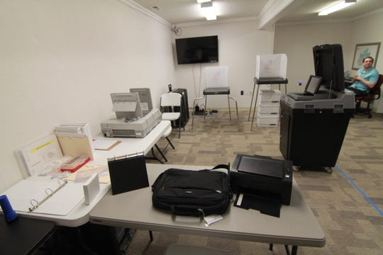 New voting equipment is arranged inside the Madison County Board of Elections office to mimic the interior of the Sandy Mush precinct.