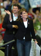 Vice presidential candidate Sarah Palin and her husband, Todd, campaign at the Asheville Civic Center on Oct. 13, 2008.