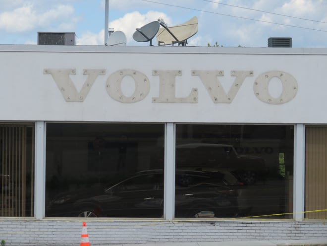 Just the shadow of the Volvo sign remains on the former Serafini dealership on the Vestal Parkway. Matthews Auto Group is taking over the Nissan franchise, and the Volvo dealership has been abandoned