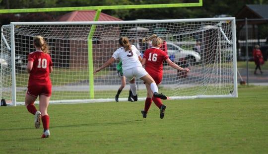 Owen junior Camryn Bolick fires a shot at the Hendersonville goal in a 1-0 Warlassies loss in the fourth round of the state playoffs on May 15.
