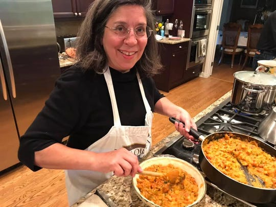 Ann Maloney of New Orleans spoons the filling into the crust for crawfish pie.