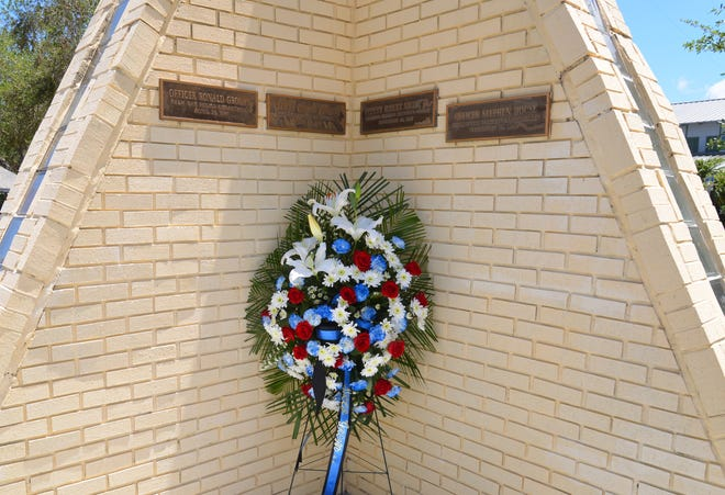 An annual wreath-laying ceremony is held in memory of Officers Ronald Grogan and Gerald Johnson, who died in the line of duty. The Palm Bay officers, along with four civilians, were killed by a gunman on April 23, 1987, at a Palm Bay shopping plaza.