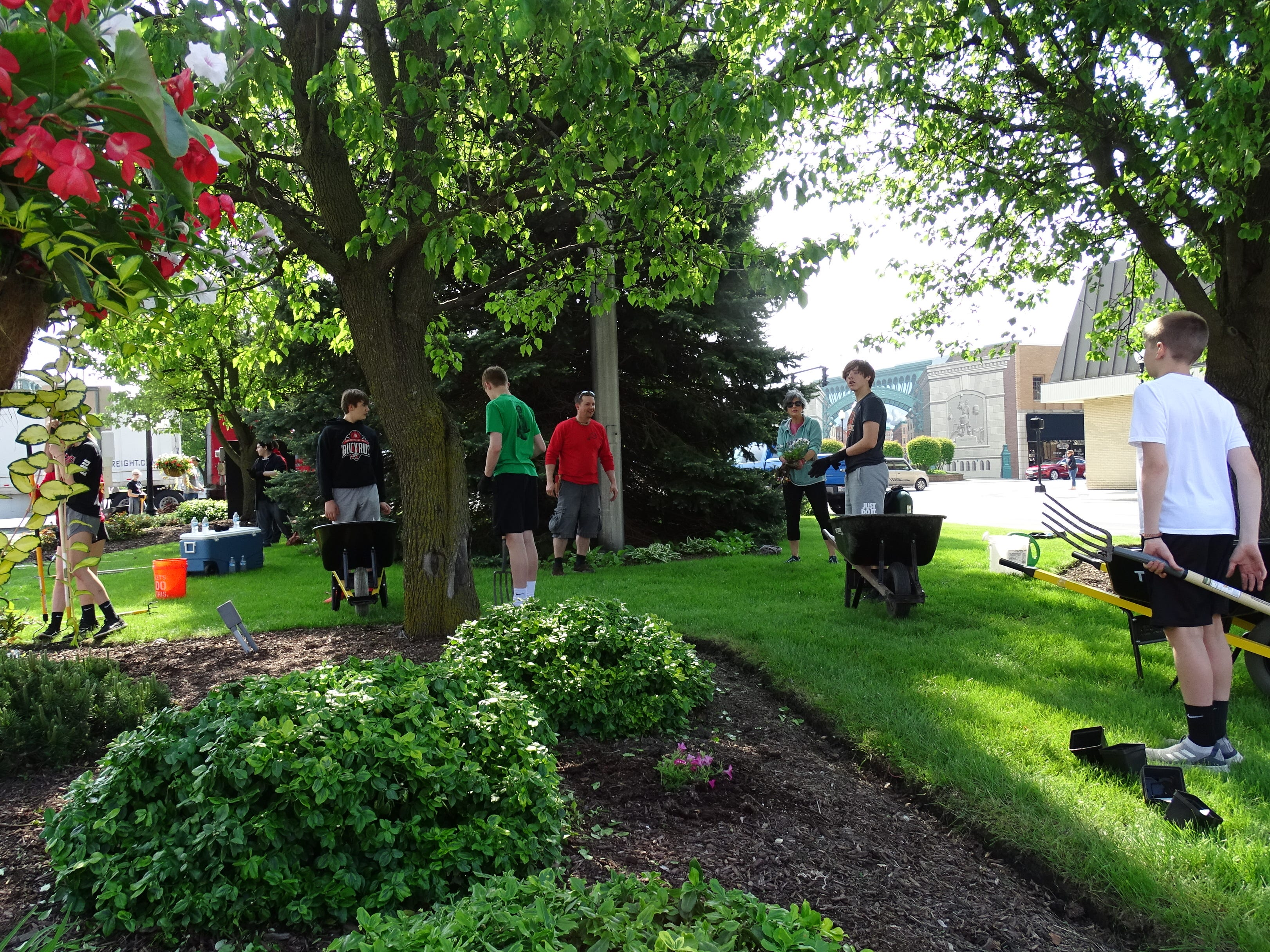 Bucyrus Middle School students from Scott Mental's landscape design class clean up the landscaping at Washington Square in downtown Bucyrus on Thursday morning.