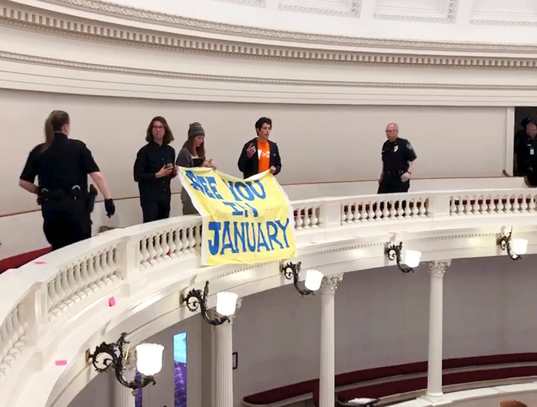 Climate protesters disrupt Vermont House session; 3 arrested