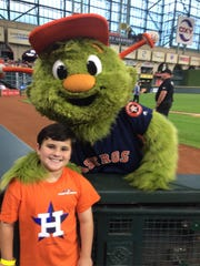 Luke Lamb poses with Houston Astros mascot, Orbit, on May 11.