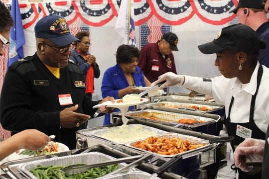 Catering team at the Zallie ShopRite in West Berlin serves veterans like Ron Toney (left) and their families last year at the annual luncheon honoring veterans at each of the seven supermarkets owned and operated by Bruce and George Zallie in South Jersey.
